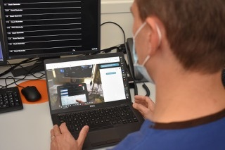Product expert follows the actions of the surgeon remotely and can give advice from a distance